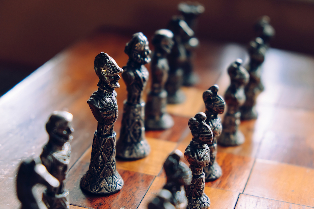 Partial view of an old Chess board with Pewter chess pieces.